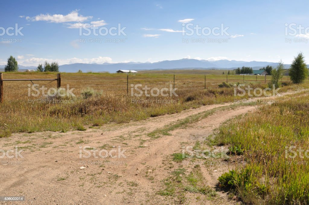 dirt road by a prairie in Colorado stock photo