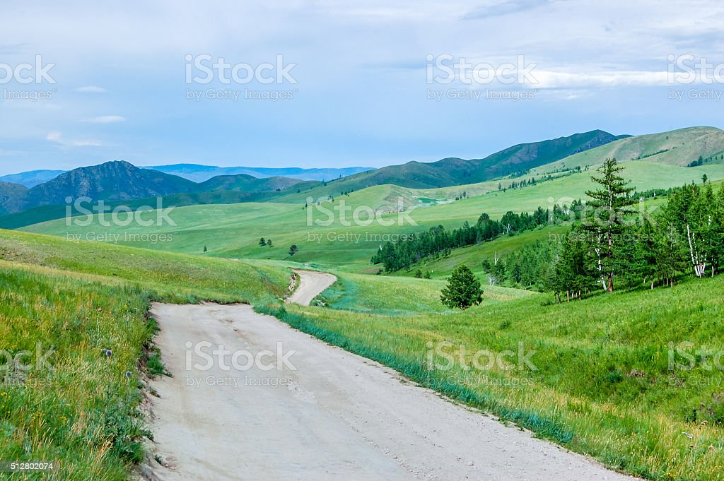 Dirt road, central Mongolian steppe stock photo