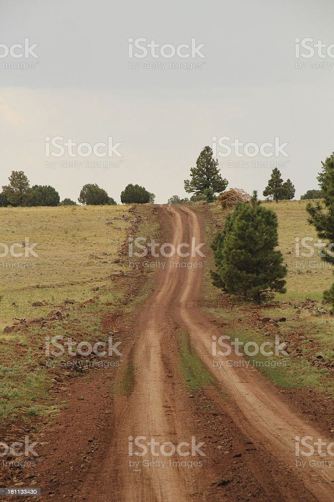 Dirt Road Hill Tire Tracks royalty-free stock photo