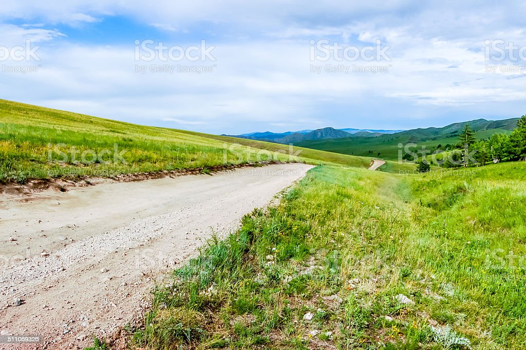 Dirt road in Central Mongolian steppe stock photo