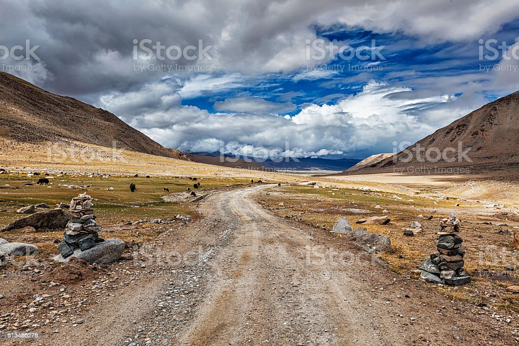 Dirt road in Himalayas stock photo