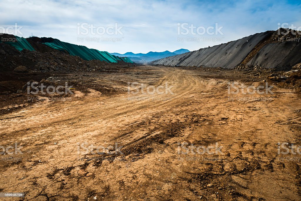 A dirt road in the middle of nowhere stock photo