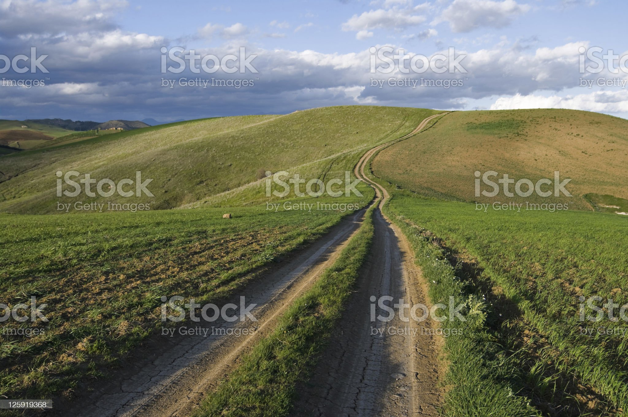 Dirt Road Leading On Top Of The Hill royalty-free stock photo