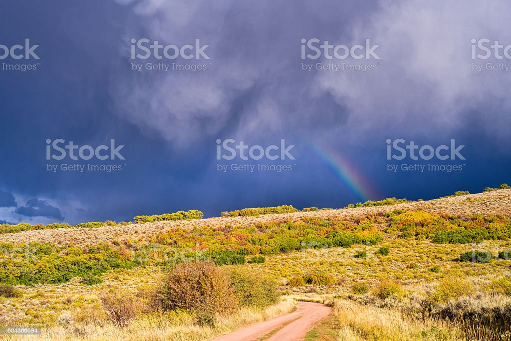Dirt Road Mountains and Rainbow stock photo