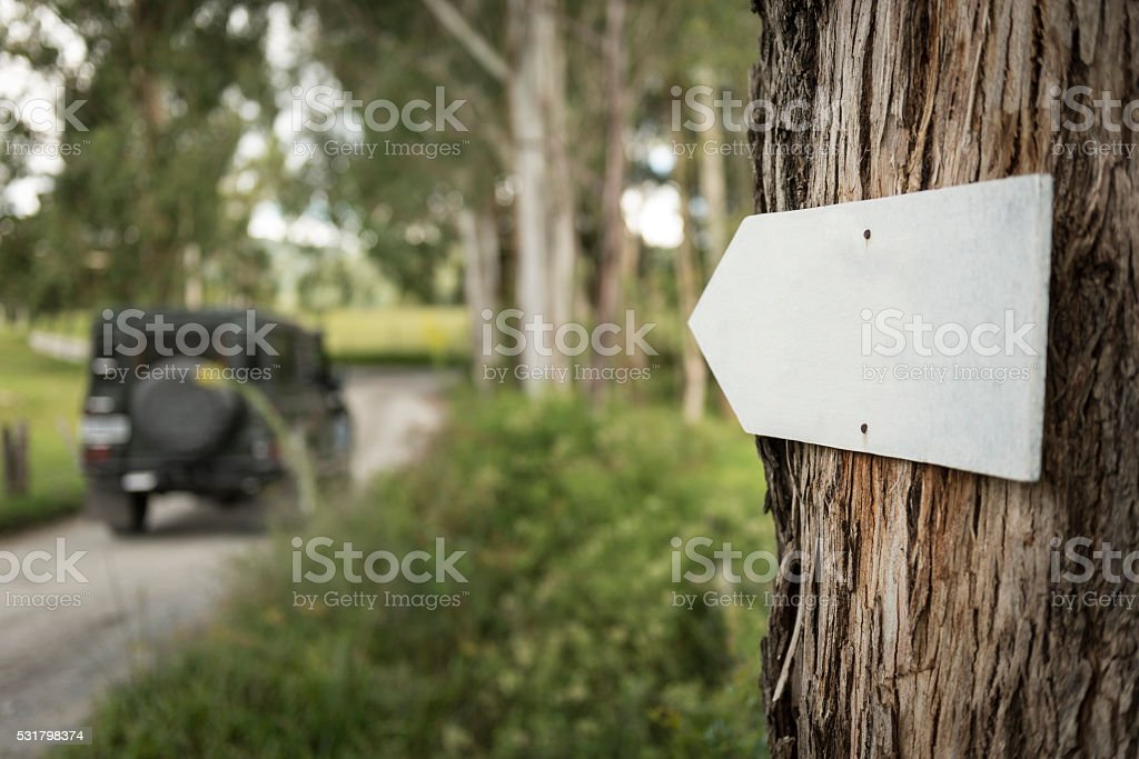 Dirt road sign stock photo