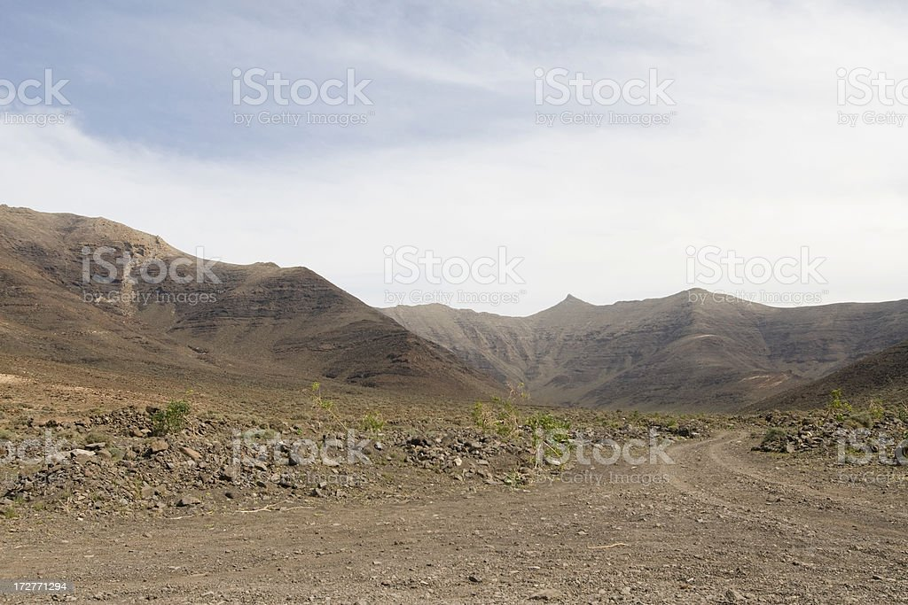 Dirt road through a valley stock photo