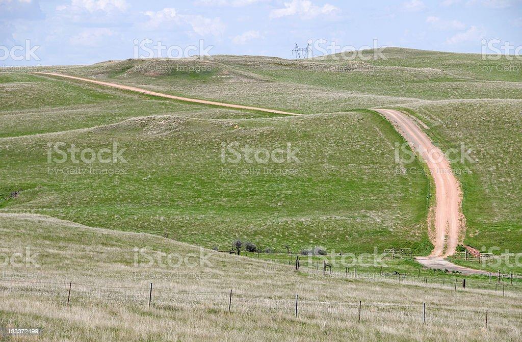 Dirt road through hills of North Dakota royalty-free stock photo