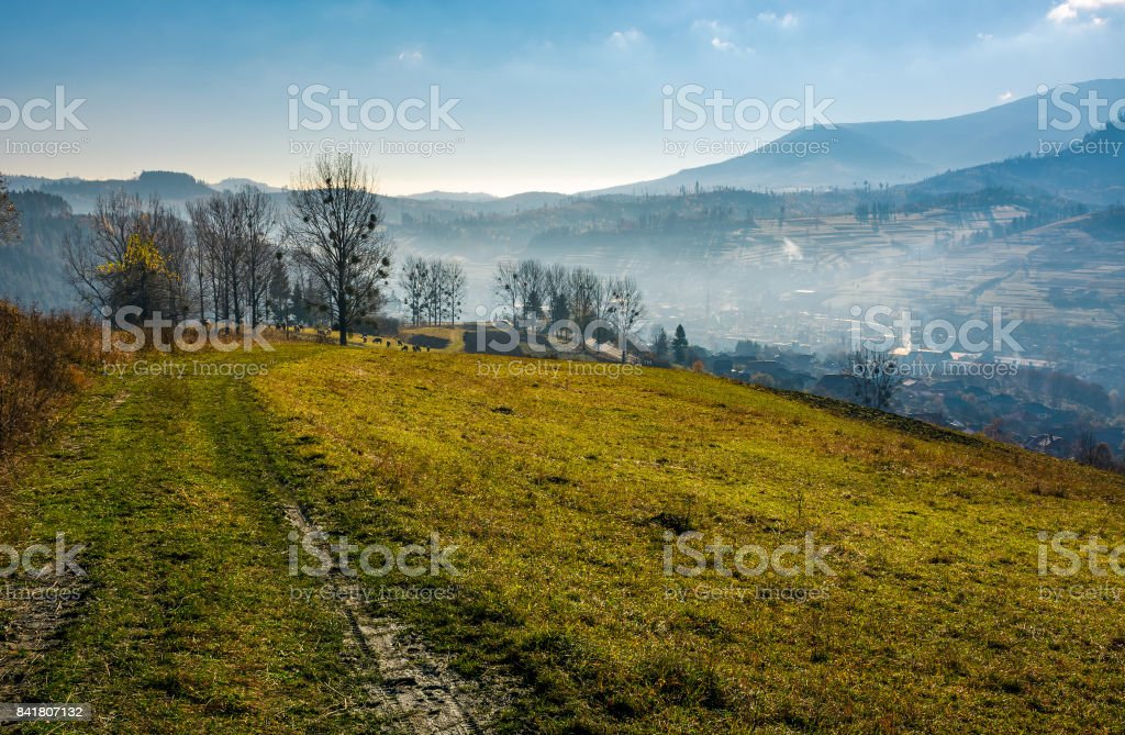 dirt road to village down the hill stock photo