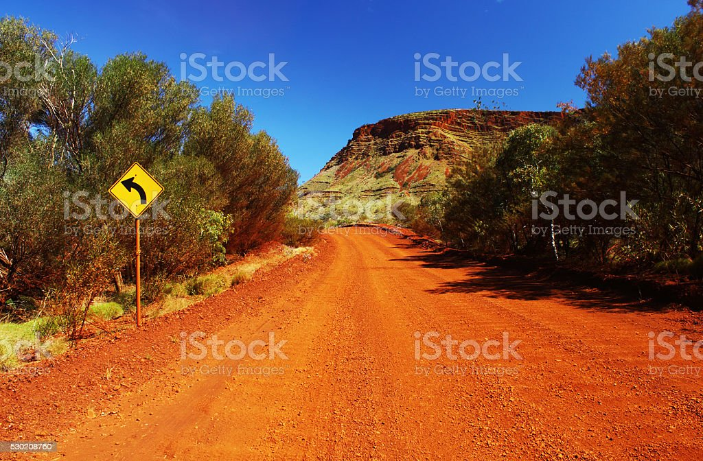 Dirt Road winding through Karijini National Park, Western Australia stock photo