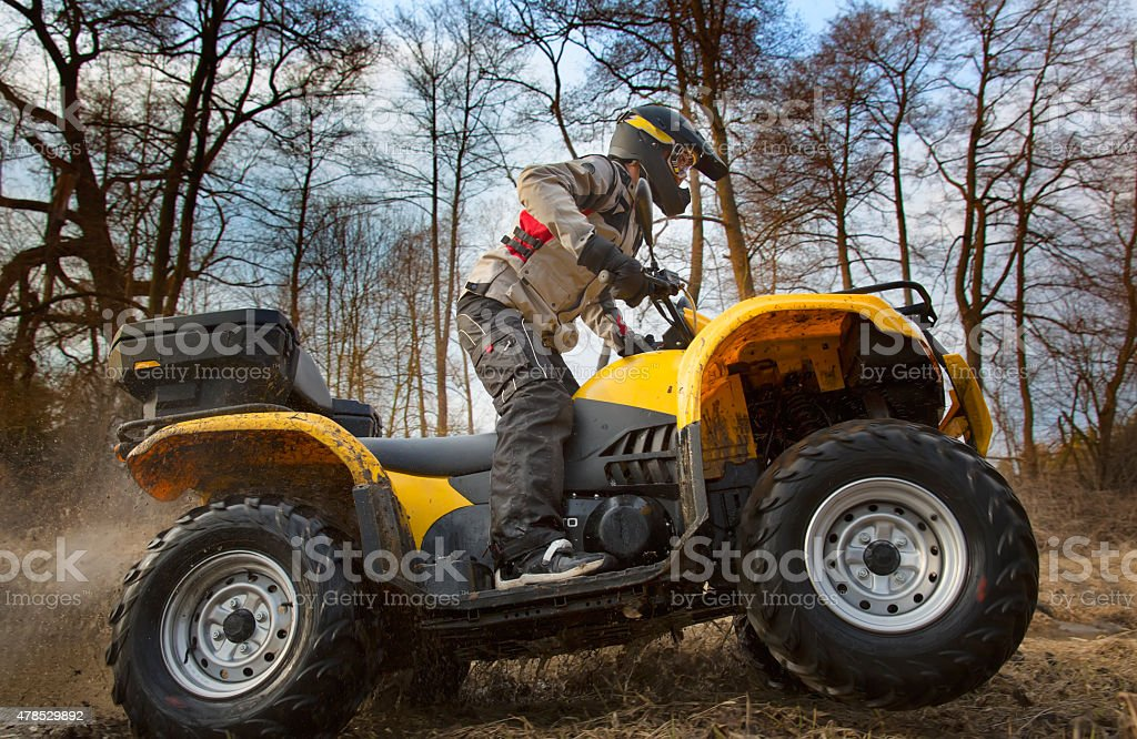 Dirt spinning of the ATV quad bike wheels stock photo