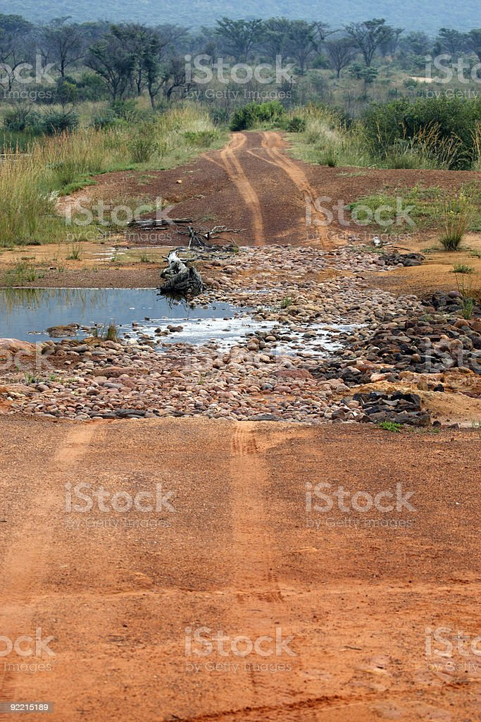 dirt track crossing a stream royalty-free stock photo
