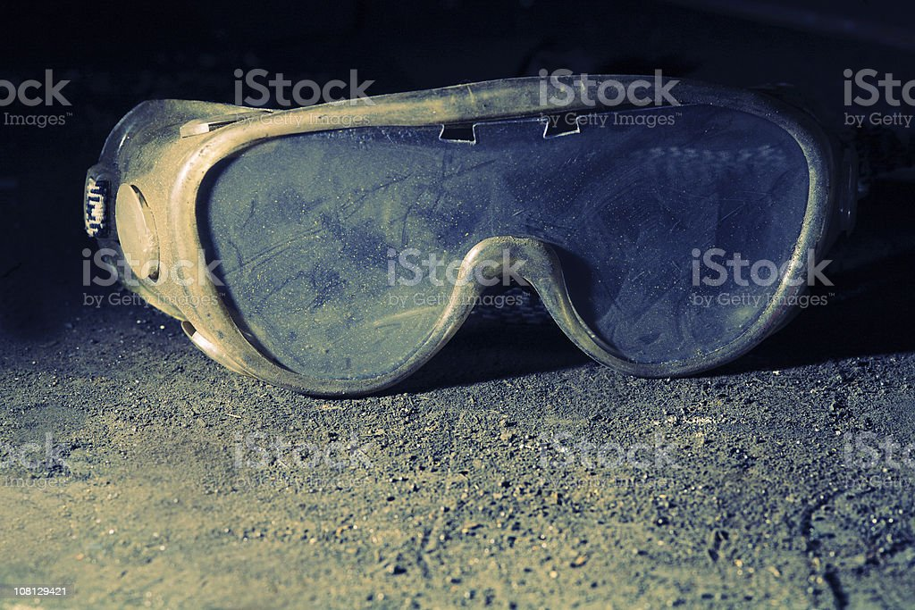 Dirty and Dusty Safety Goggles stock photo