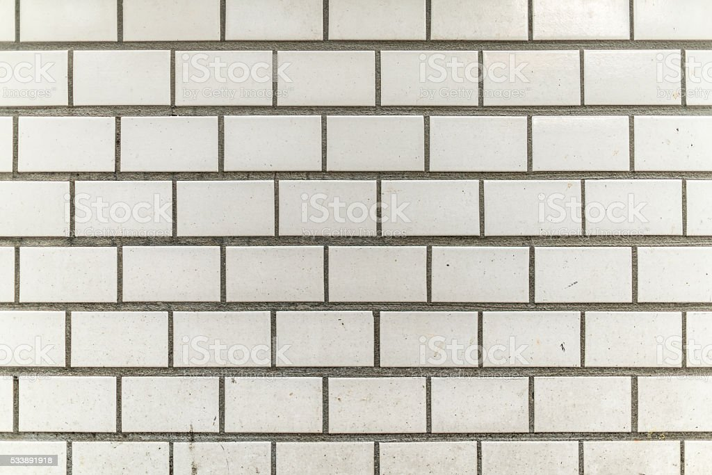 dirty and grainy white grey tile city wall stock photo