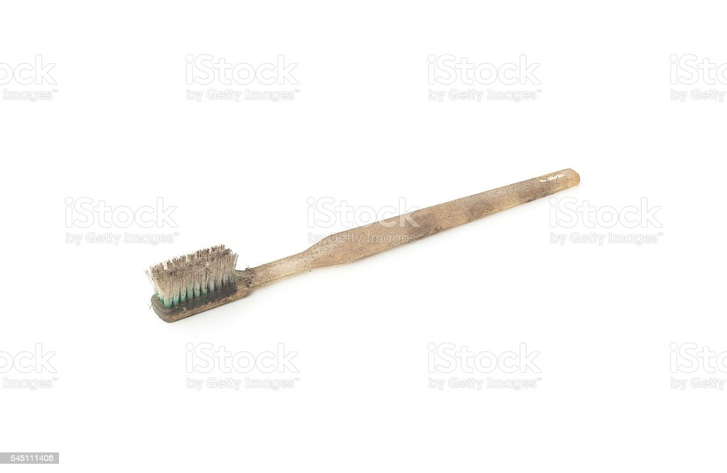 Dirty and worn out toothbrush stock photo