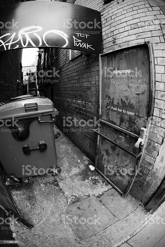 Dirty backstreet fisheye black and white royalty-free stock photo