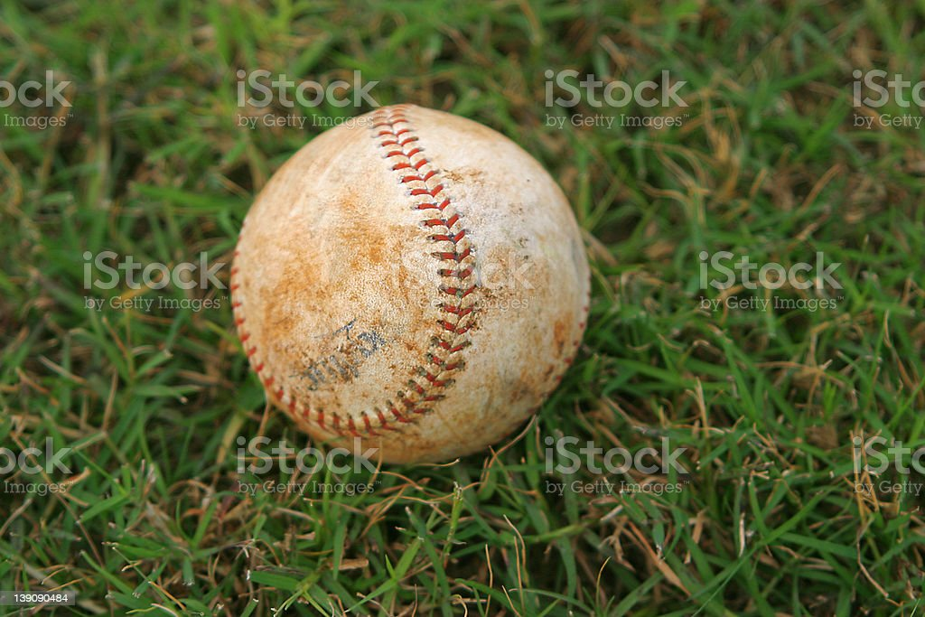 Dirty Baseball In Grass royalty-free stock photo