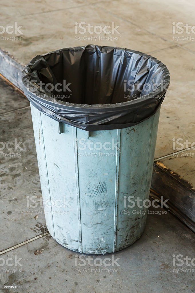 Dirty bin in garage stock photo