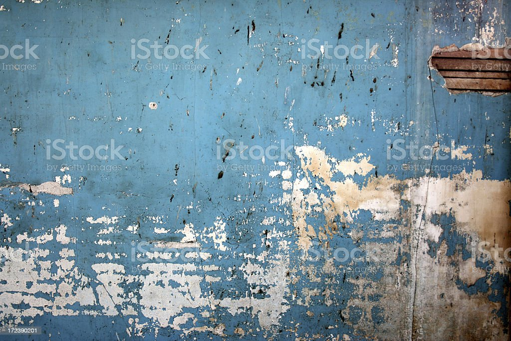 Dirty blue spattered wall background royalty-free stock photo