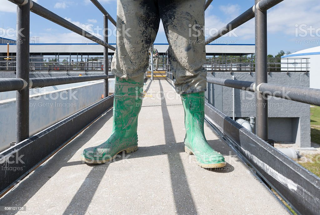 Dirty Boots after Cleaning Water Tanks stock photo