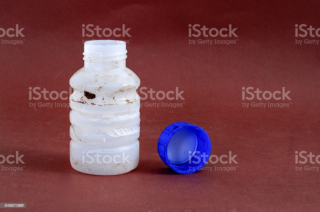 Dirty Bottle of chemical liquid stock photo