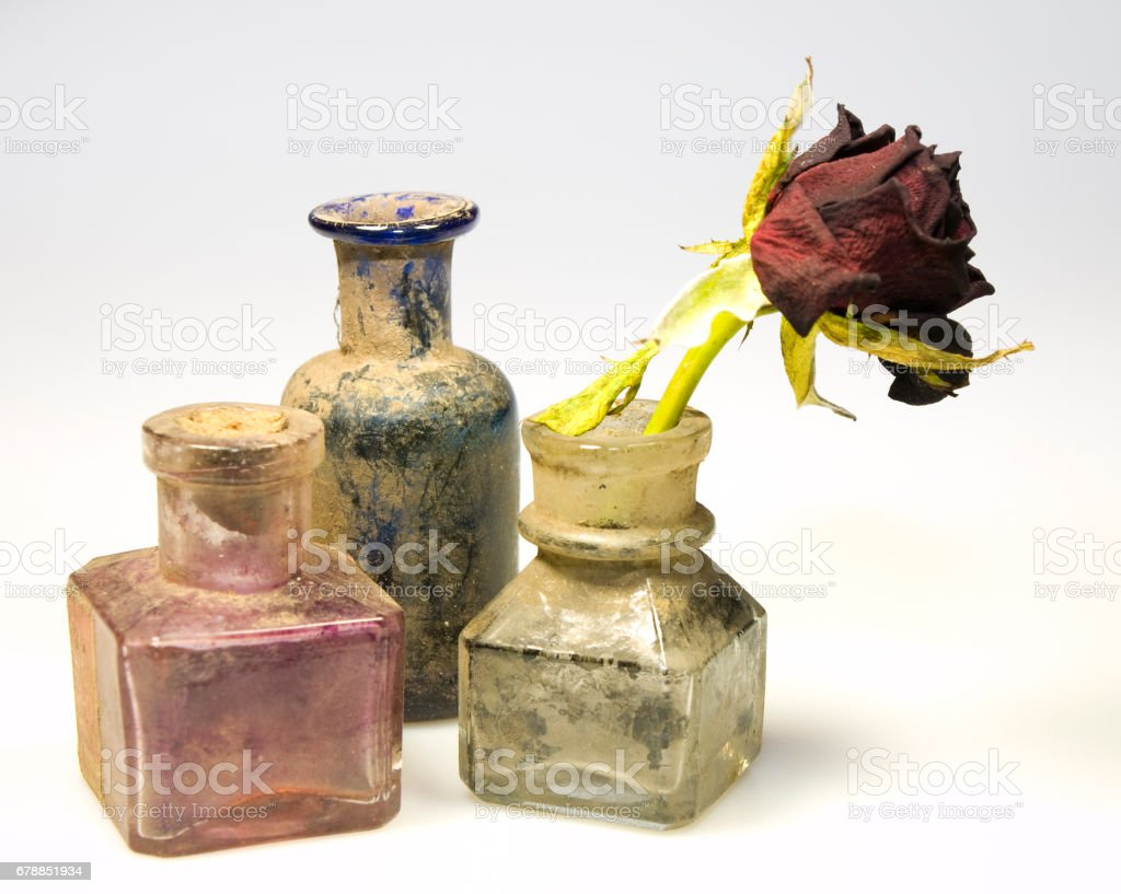 Dirty bottles with rose stock photo
