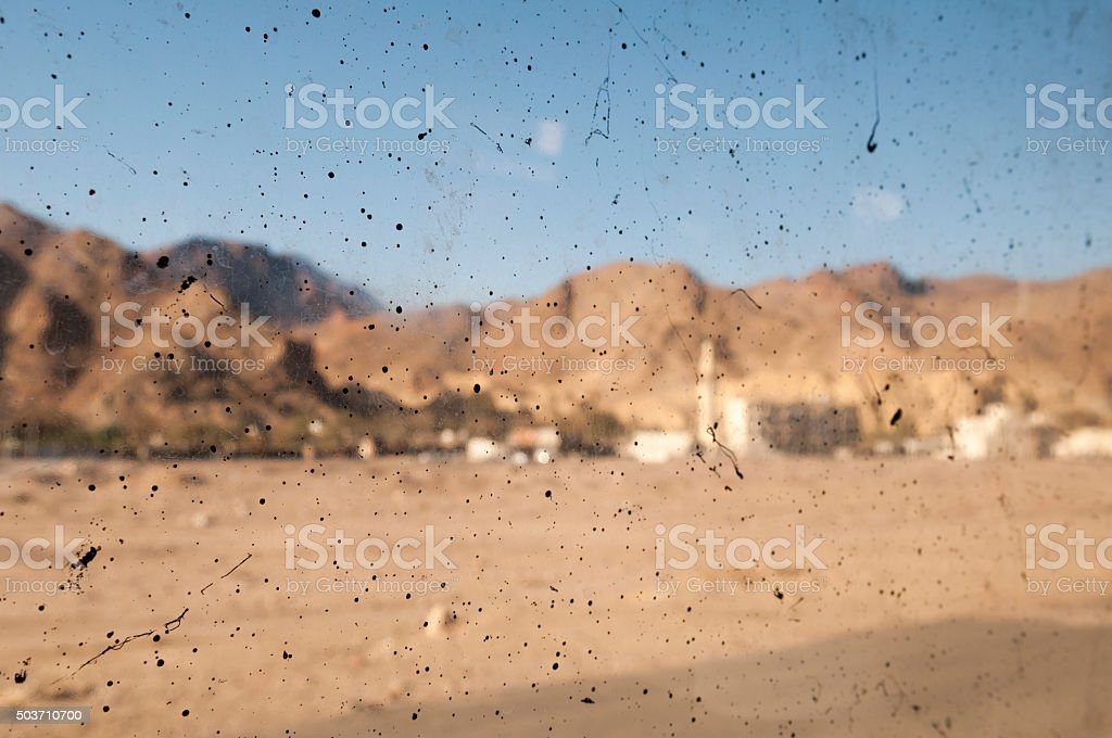 Dirty bus window in Sinai, Egypt stock photo