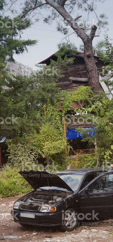 Dirty Car and damaged Tree House after Flood Disaster royalty-free stock photo