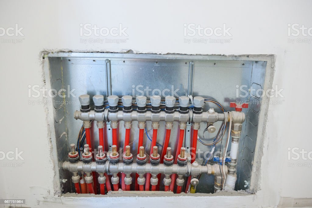 Dirty central heating valves stock photo