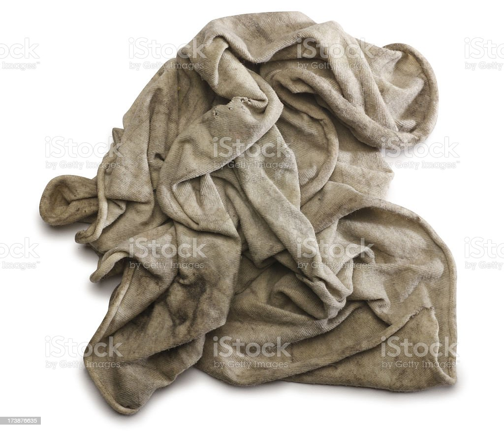 Dirty cleaning rag against white background stock photo