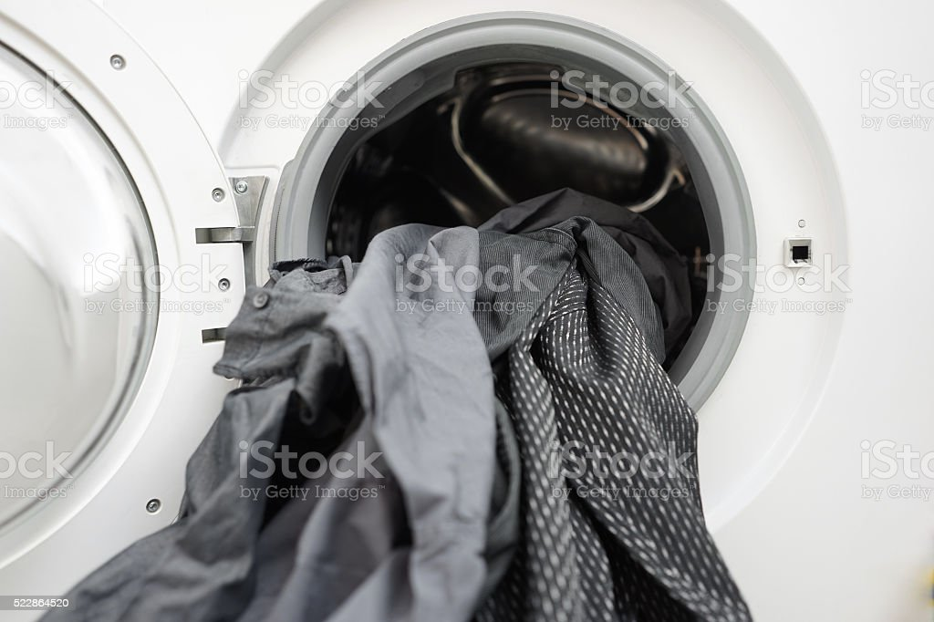 dirty clothes are  waiting  for the laundry stock photo
