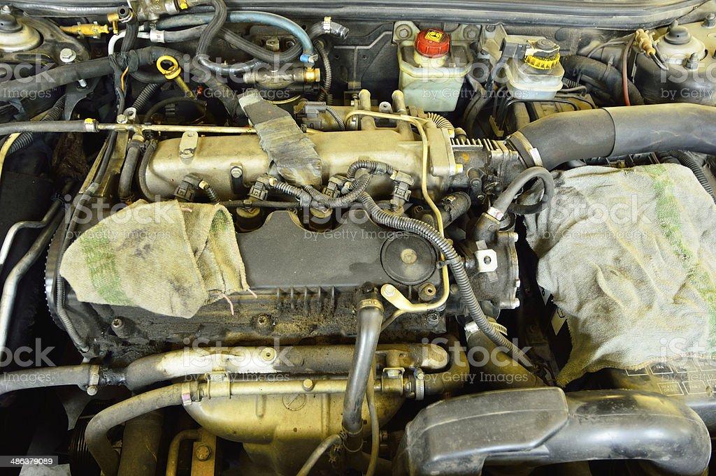 dirty diesel engine requiring repair stock photo