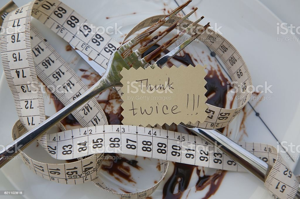 Dirty dish, measuring band and a message left stock photo