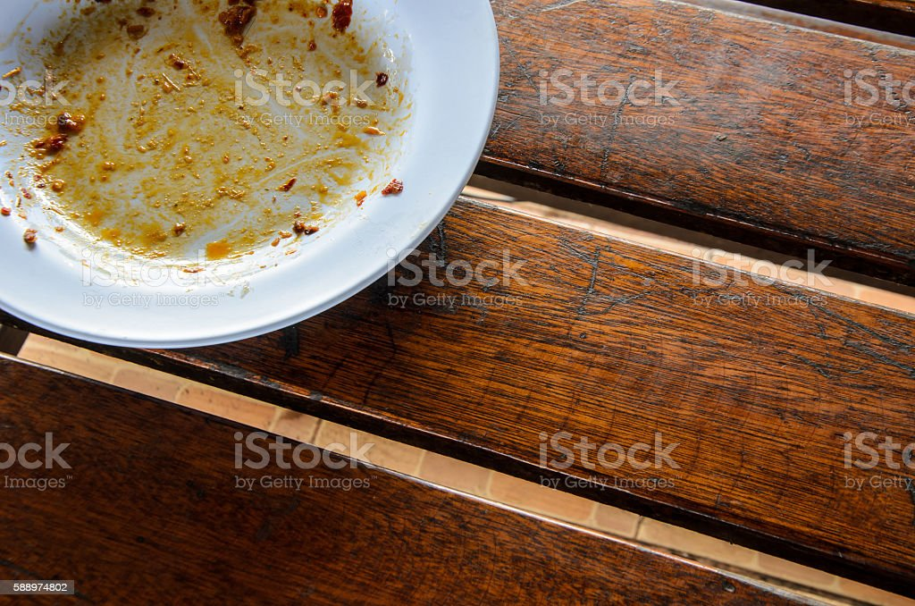 Dirty dish on dirty wood table stock photo