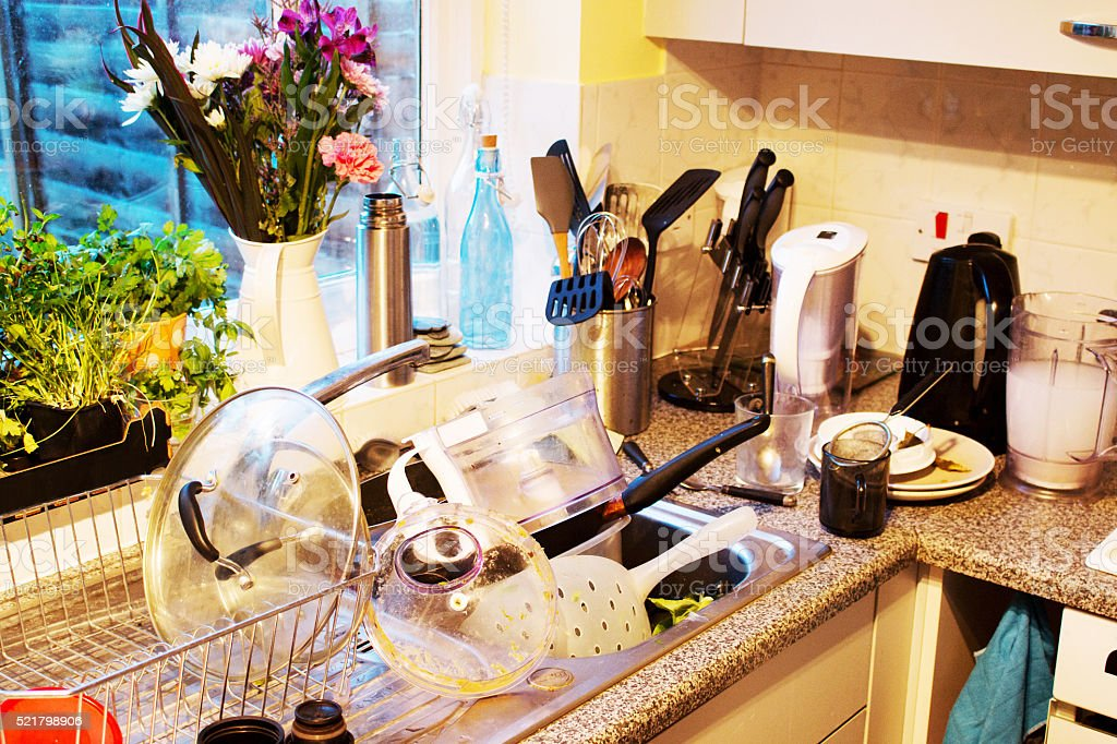 dirty dishes in kitchen sink stock photo