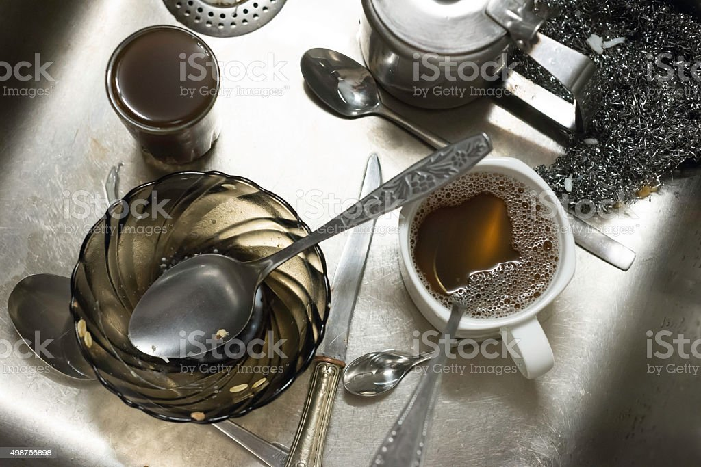 Dirty dishes in sink stock photo