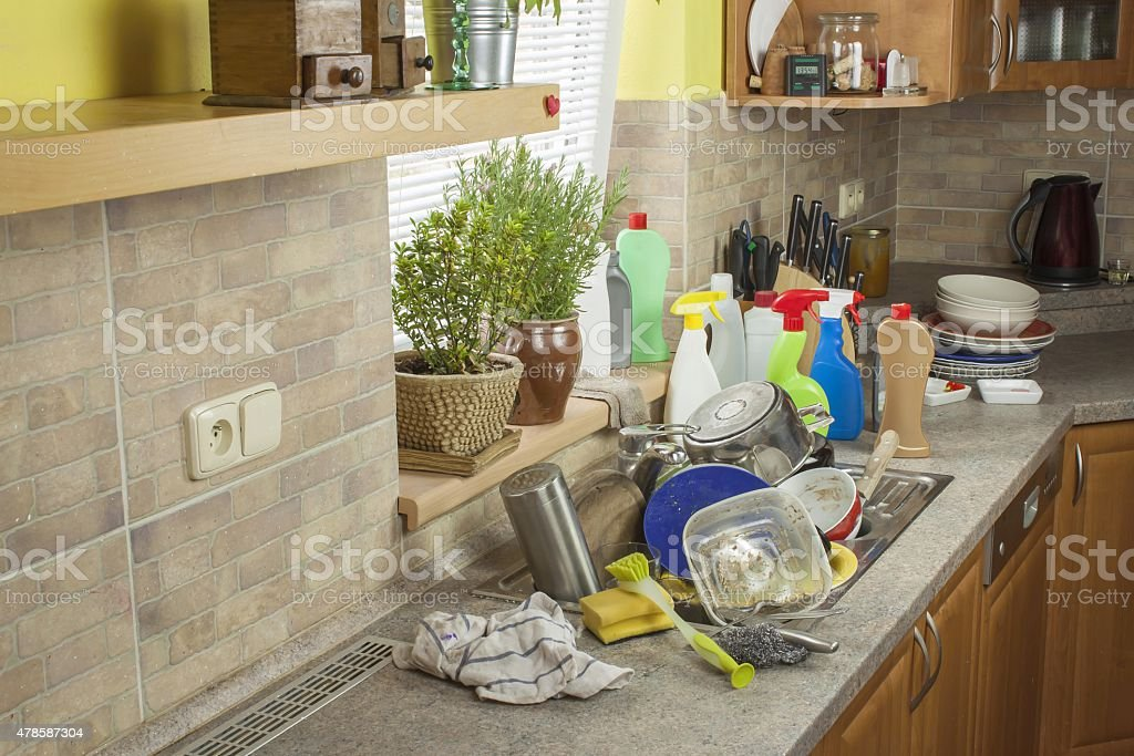 Dirty dishes in the sink after family celebrations. stock photo