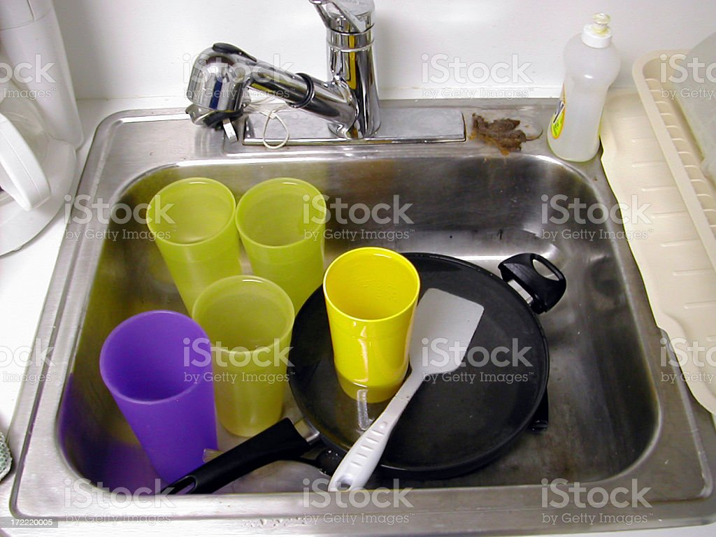 dirty dishes in the sink royalty-free stock photo
