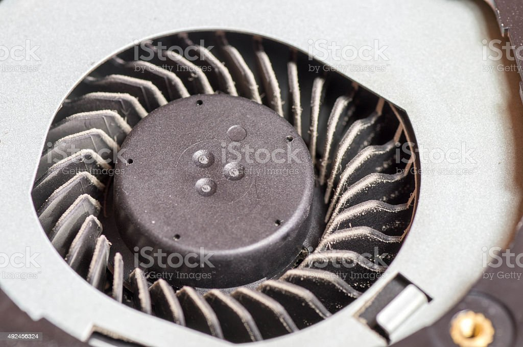 Dirty, dusty laptop cooling fan stock photo