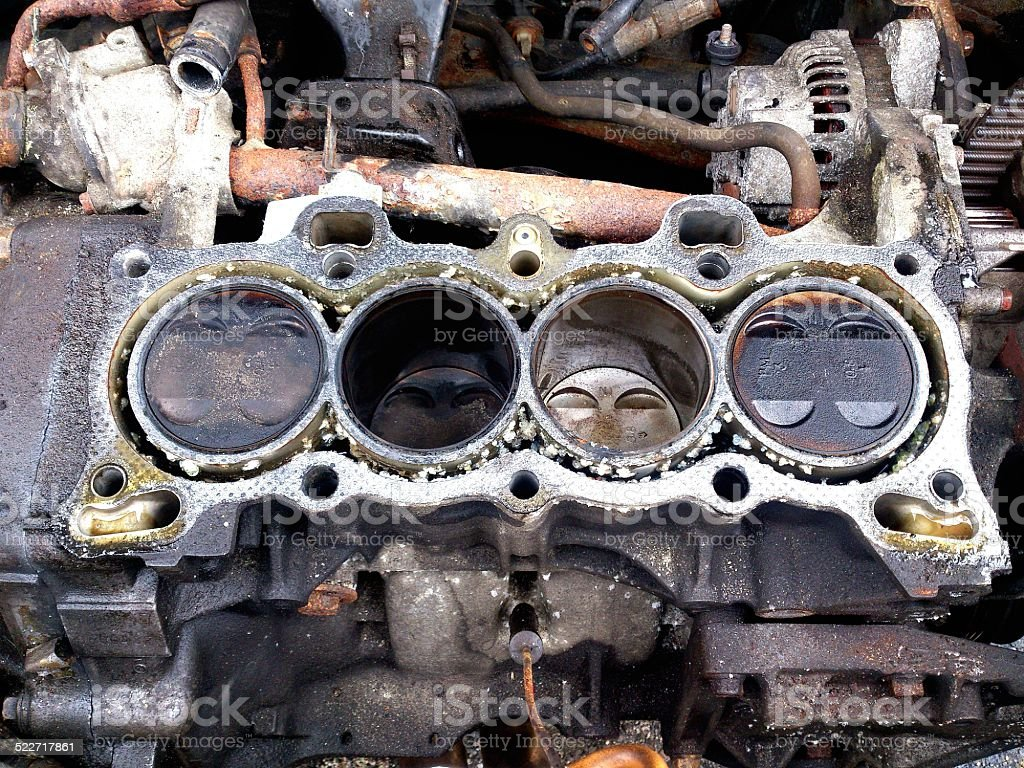 Dirty engine bay with pistons exposed stock photo