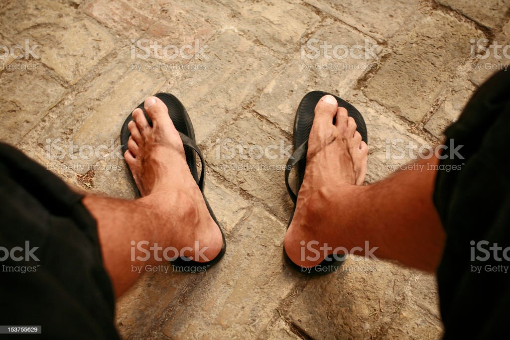 Dirty Feet of a Worker or Tourist stock photo