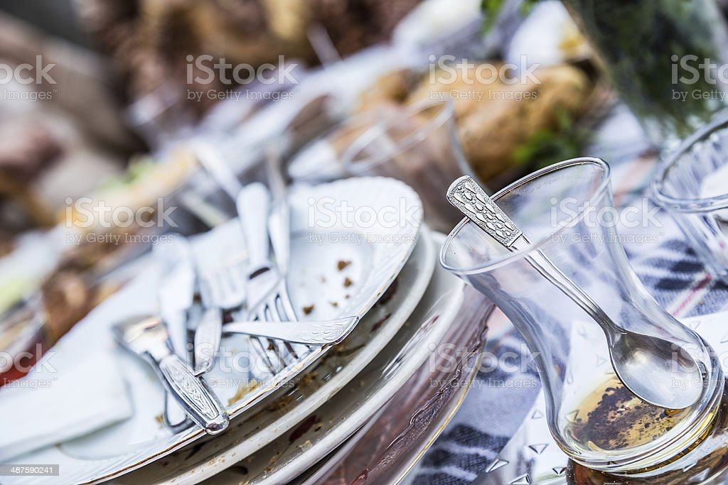 dirty glasses and plates stock photo