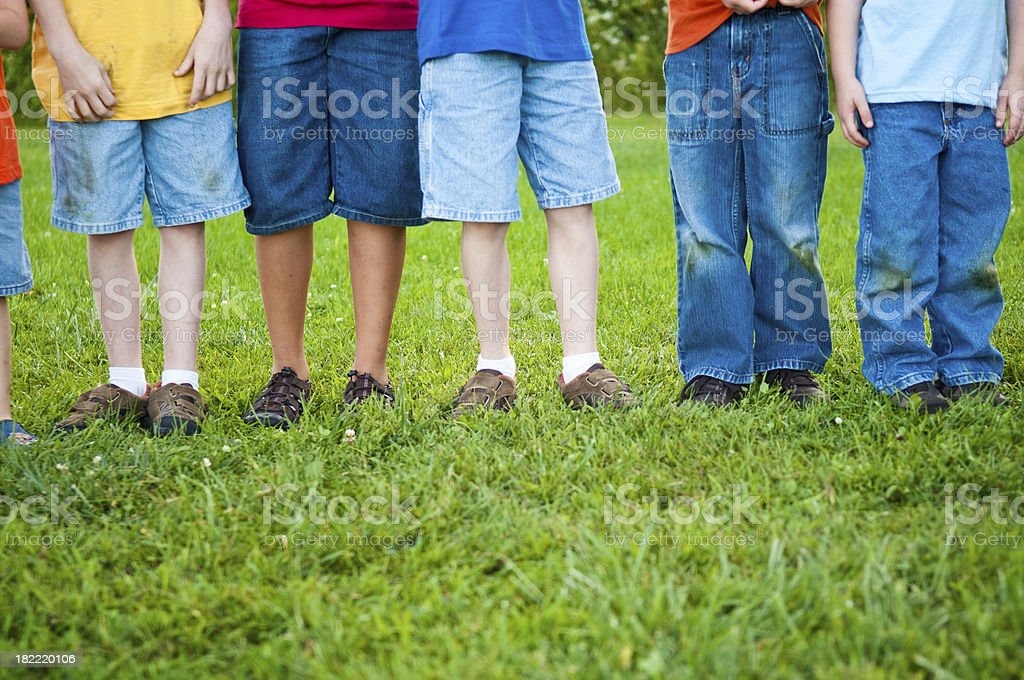 Dirty, Grass-Stained Jeans on Boys' Legs royalty-free stock photo