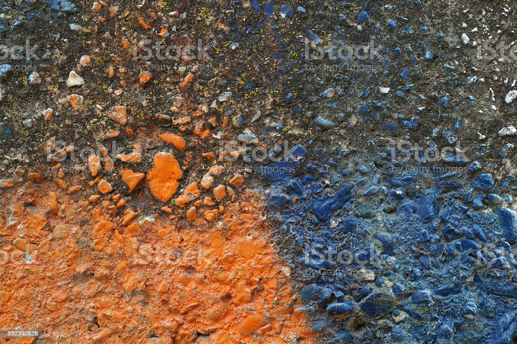 Dirty grey concrete wall with blue colored stones 15 stock photo