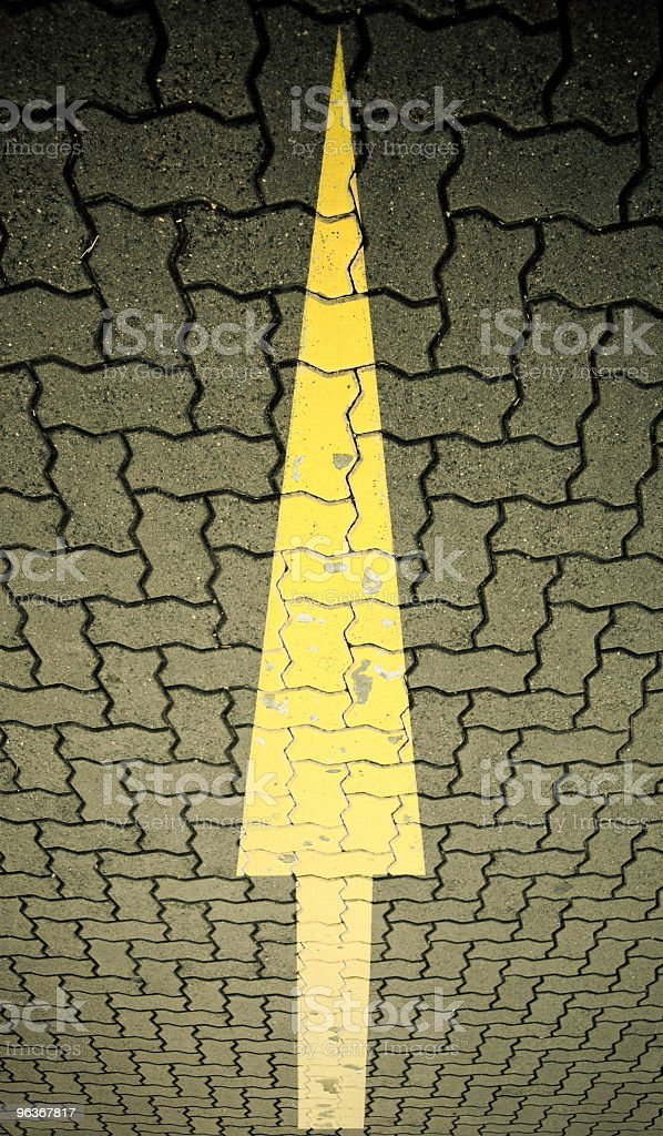 dirty grunge road sign with yellow arrow at odd angle stock photo
