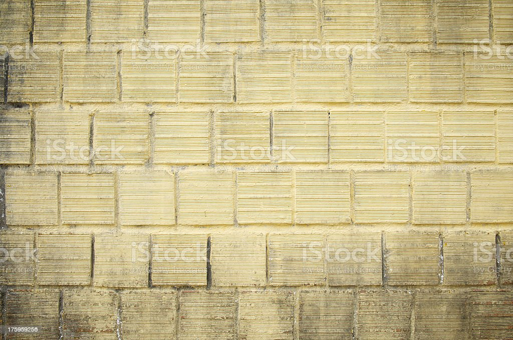 Dirty Grungy Textured Yellow Block Wall Background royalty-free stock photo