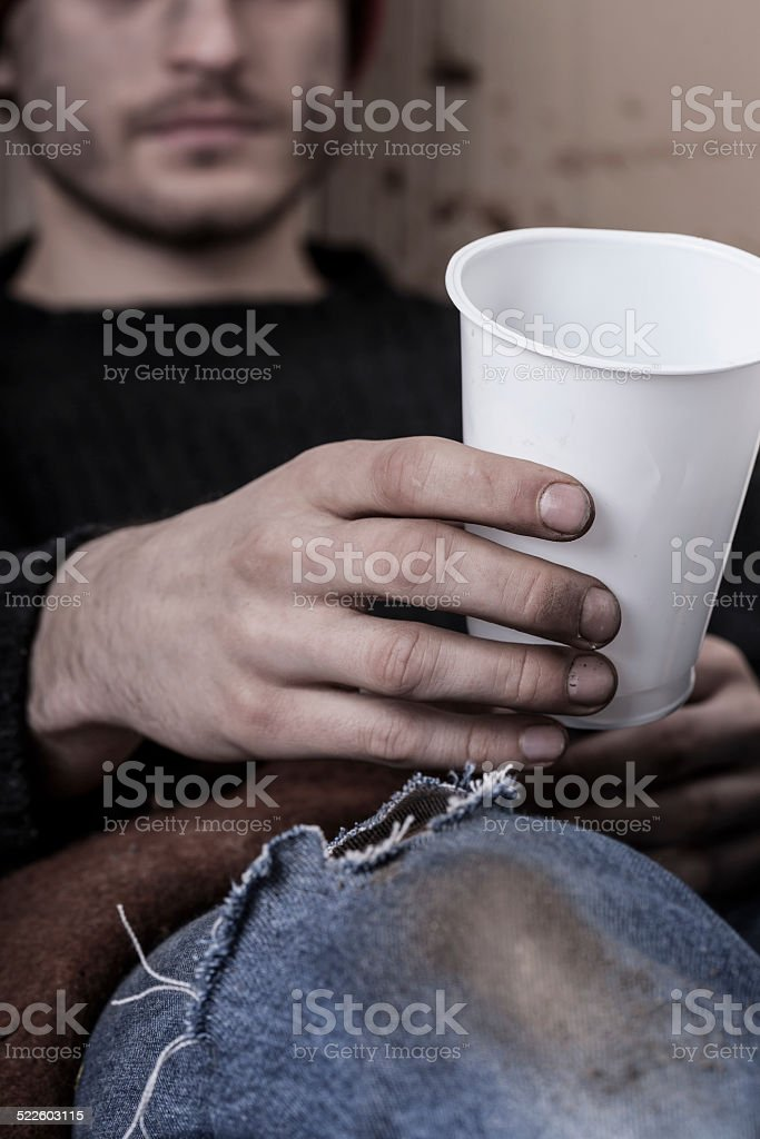 Dirty homeless person asks for money stock photo