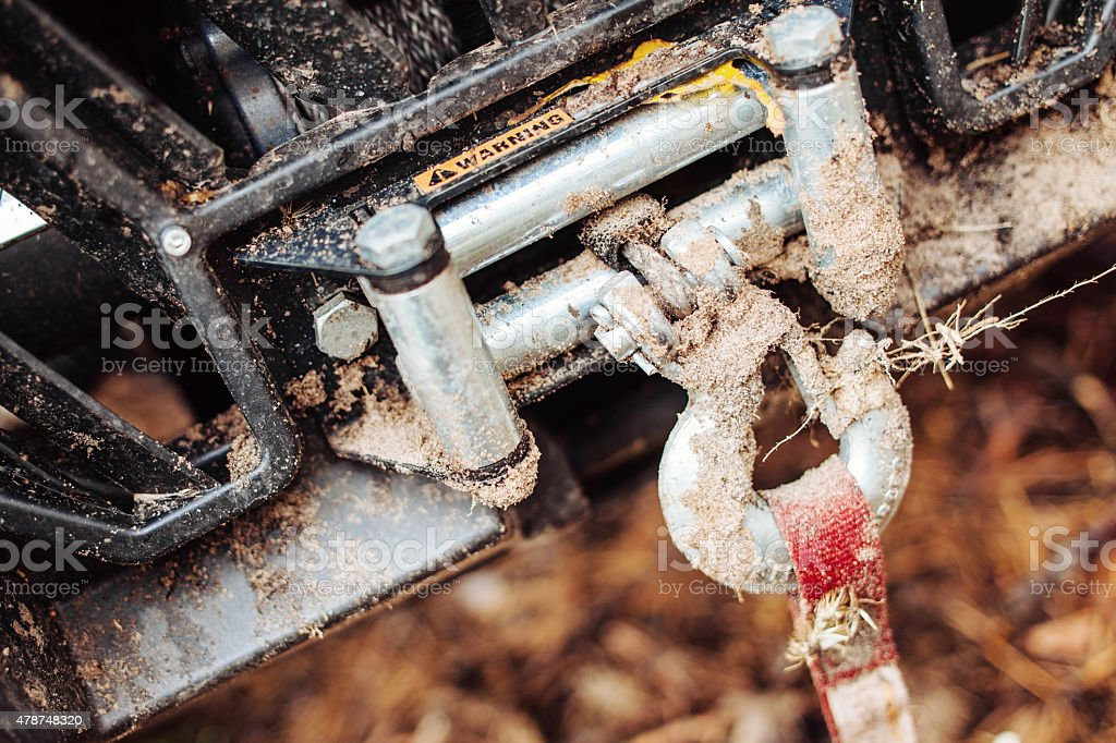 dirty hook winch bumper atv stock photo