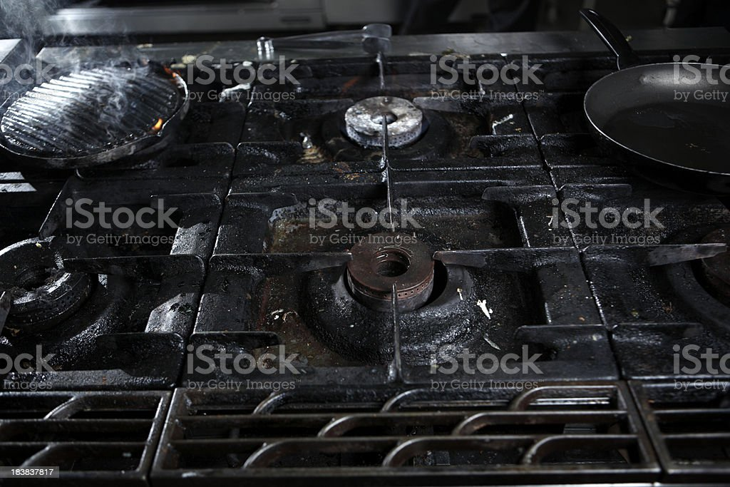 Dirty kitchen stove royalty-free stock photo