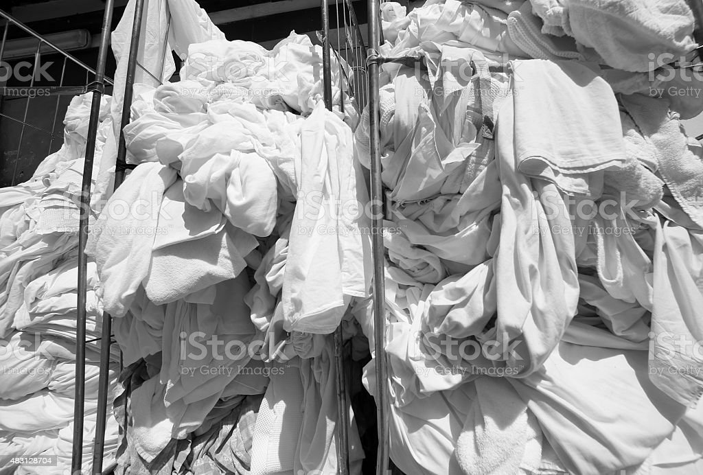 dirty laundry in the industrial laundry before washing stock photo