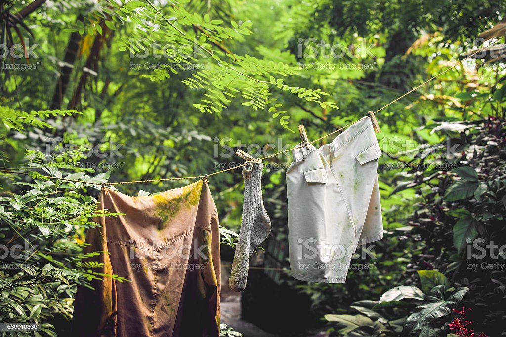 Dirty laundry on a wire stock photo